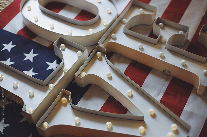 American Flag with the word LOVE on it in metal illuminated letters by Greg Schmigel for Stocksy United