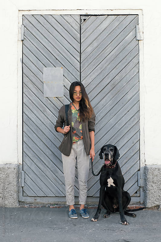 Portrait of Asian girl with dog on leash by Danil Nevsky for Stocksy United