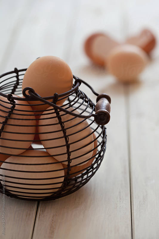eggs in a basket by Federica Di Marcello for Stocksy United