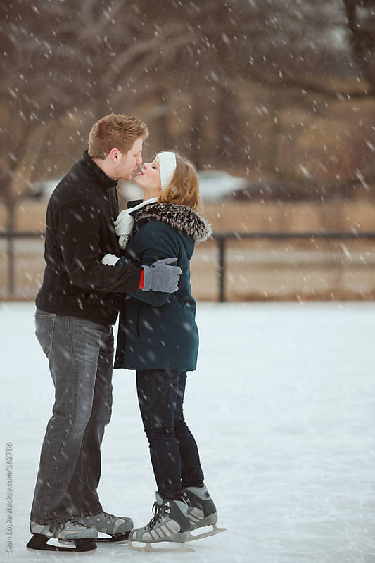 Skating: Couple Sharing a Kiss on the Ice by Sean Locke for Stocksy United