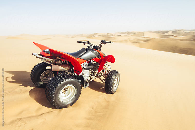 ATV on desert sand dunes landscape by Alejandro Moreno de Carlos for Stocksy United