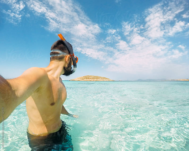 Young man at the beach snorkelling by ACALU Studio for Stocksy United