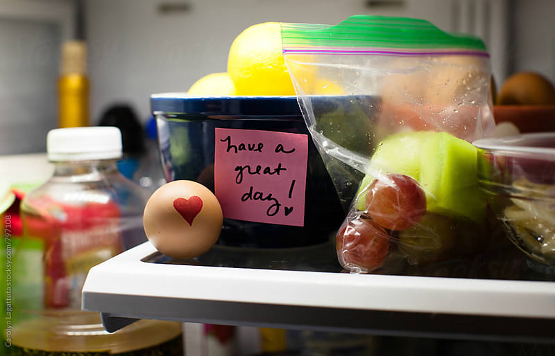 Love notes written on a homemade lunch in the refrigerator by Carolyn Lagattuta for Stocksy United