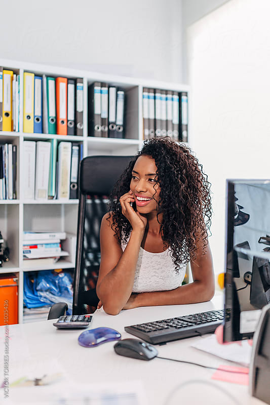African American Businesswoman on the Phone at the Office by VICTOR TORRES for Stocksy United