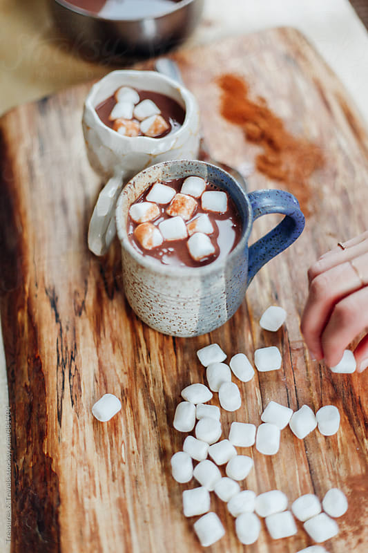 hot chocolate and marshmallows on wooden table by Treasures & Travels for Stocksy United