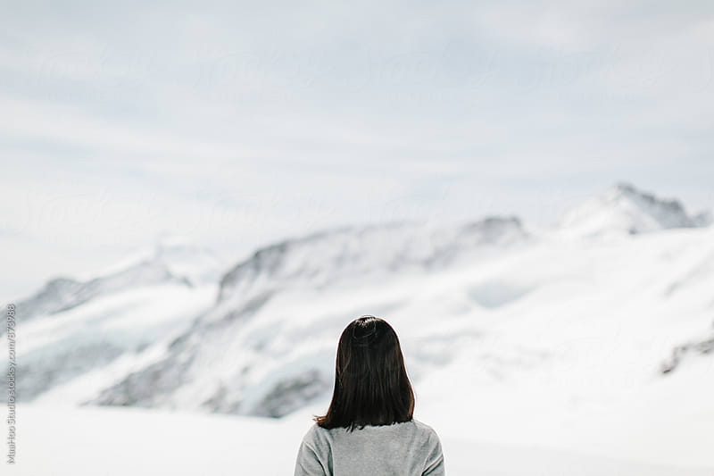 Back profile of a young woman,Swiss Alps, Switzerland by MaaHoo Studio for Stocksy United