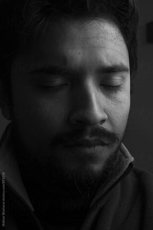 Close up portrait of a man with his eyes closed. by Shikhar Bhattarai for Stocksy United