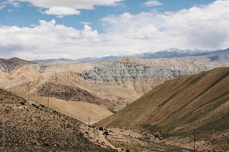 Deserted landscape of Upper Mustang on the Tibetan Plateau. by Shikhar Bhattarai for Stocksy United