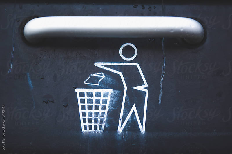 Trash sign on a trash bin by Luca Pierro for Stocksy United