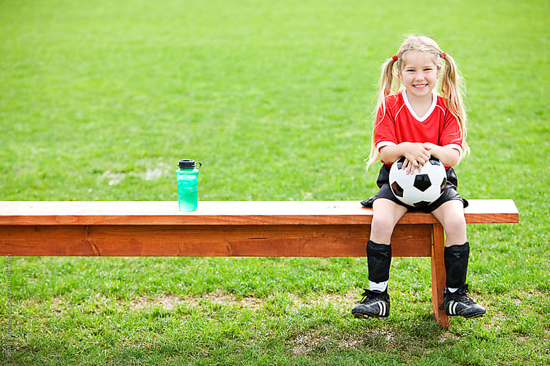Soccer: Girl Sits on Bench with Ball by Sean Locke for Stocksy United