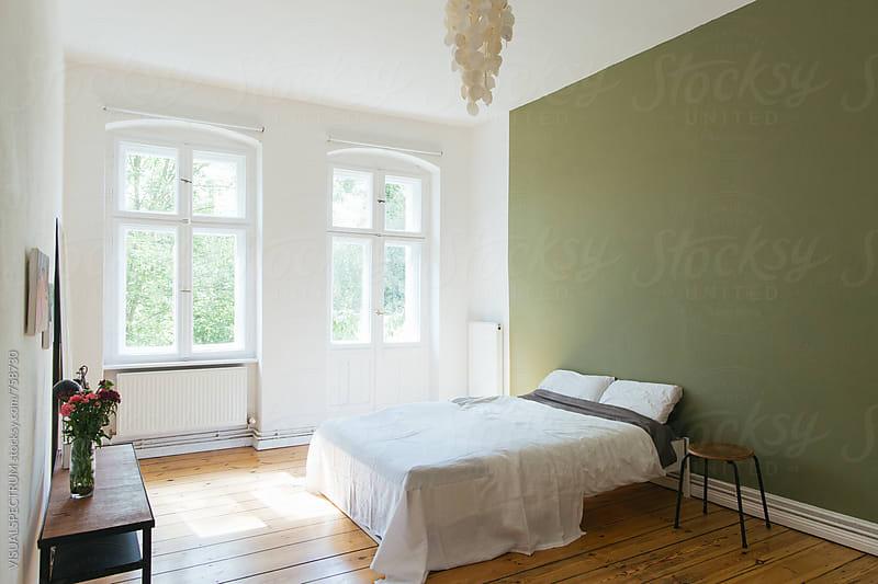 Minimalist Naturally-Lit Bedroom by Julien L. Balmer for Stocksy United