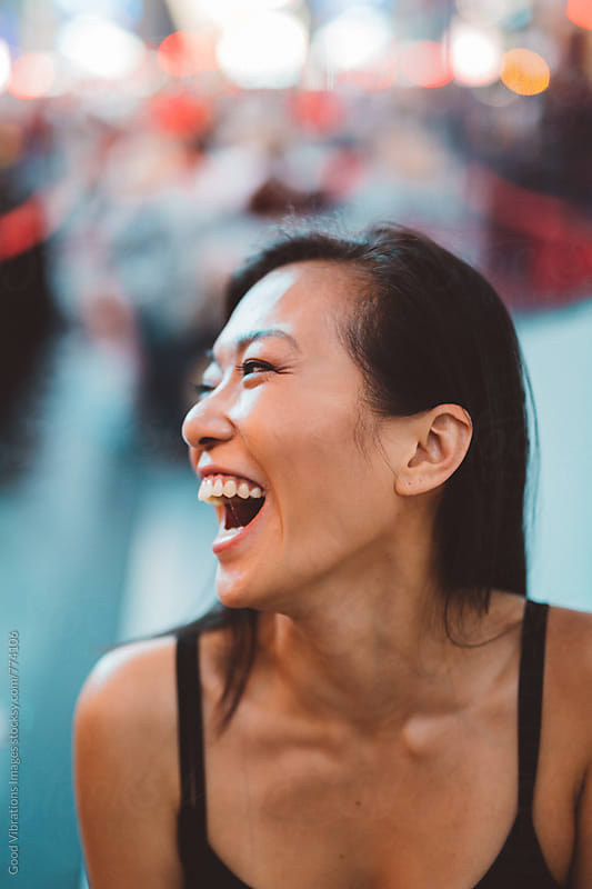 Smiling Asian Woman portrait in Time Square by Good Vibrations Images for Stocksy United