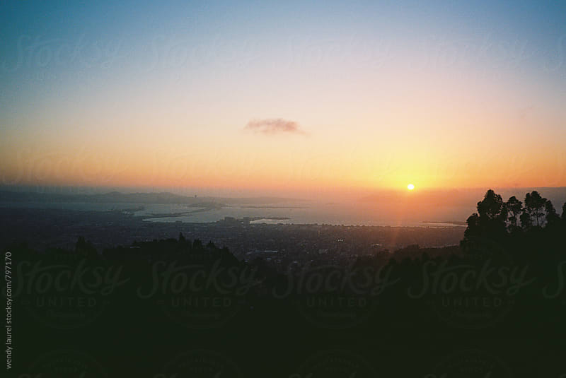 sunset over berkeley hills and san francisco bay on film  by wendy laurel for Stocksy United