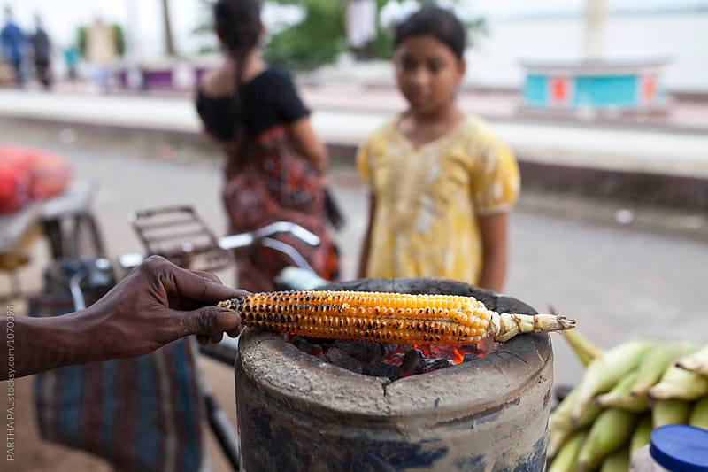 Maize is baked and selling in roadside by PARTHA PAL for Stocksy United