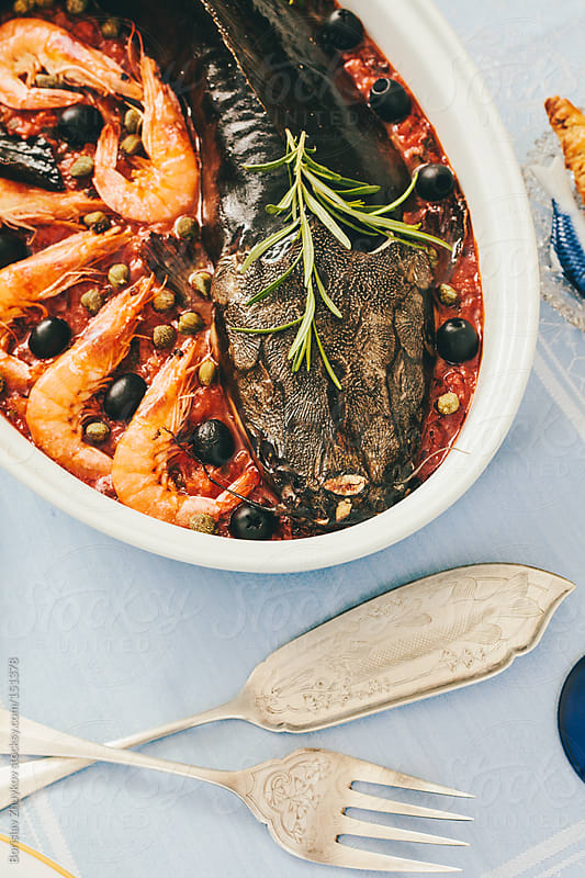 Mediterranean catfish and shrimps with capers and tomato paste by Borislav Zhuykov for Stocksy United