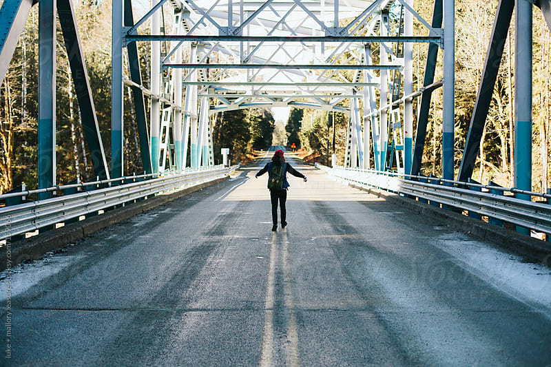 Young man on a bridge by luke + mallory leasure for Stocksy United