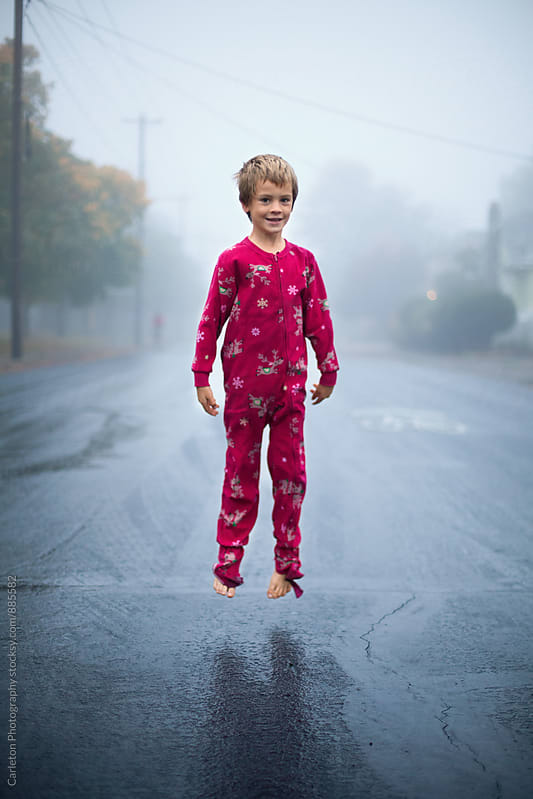 Levitating boy in pajamas by Carleton Photography for Stocksy United