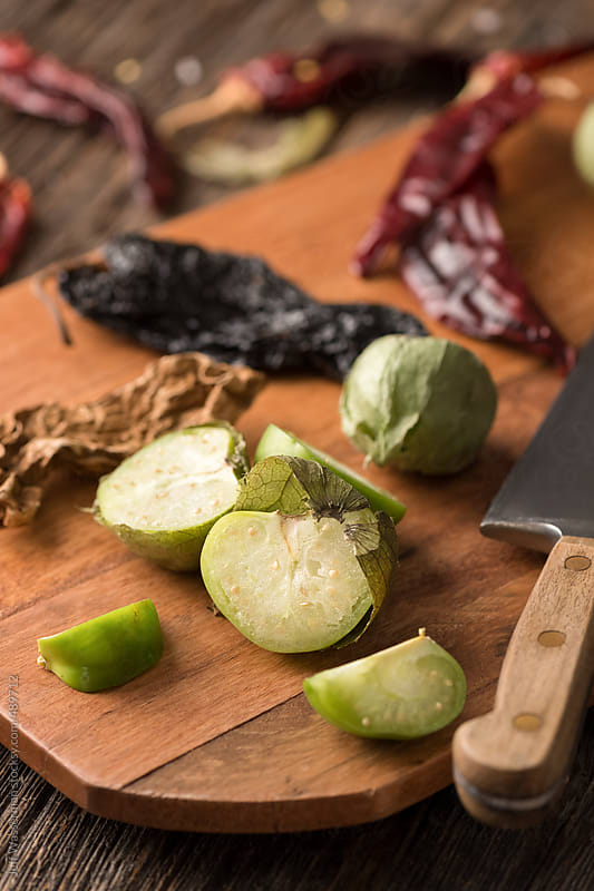Mexican Food Ingredients: Tomatillos with Chile Peppers by Jeff Wasserman for Stocksy United