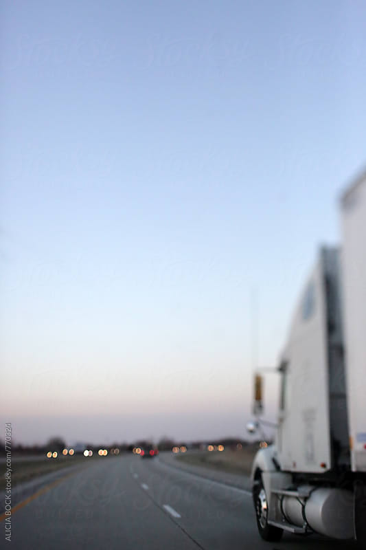 Passing A Semi Truck On The Highway During On A Clear Evening by ALICIA BOCK for Stocksy United
