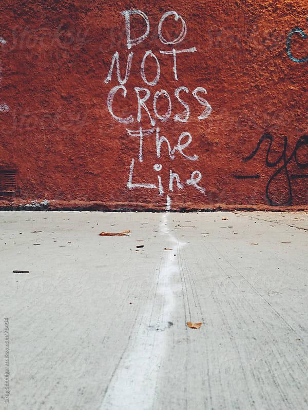 Do not cross the line graffiti street photography by Greg Schmigel for Stocksy United