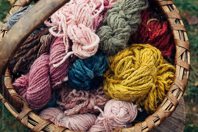 Various color wool yarn in a basket by Gabriel (Gabi) Bucataru for Stocksy United