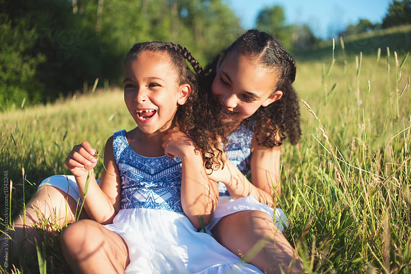 Young sisters having fun in the summertime by Chelsea Victoria for Stocksy United