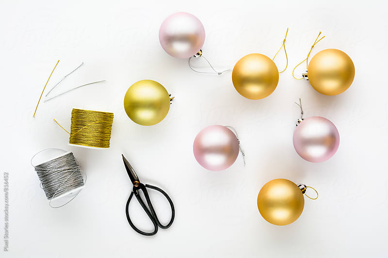 Cutting bauble hangers by Pixel Stories for Stocksy United