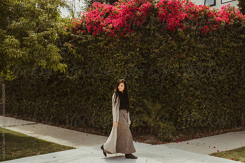 Lady walking alone by Isaiah & Taylor Photography for Stocksy United