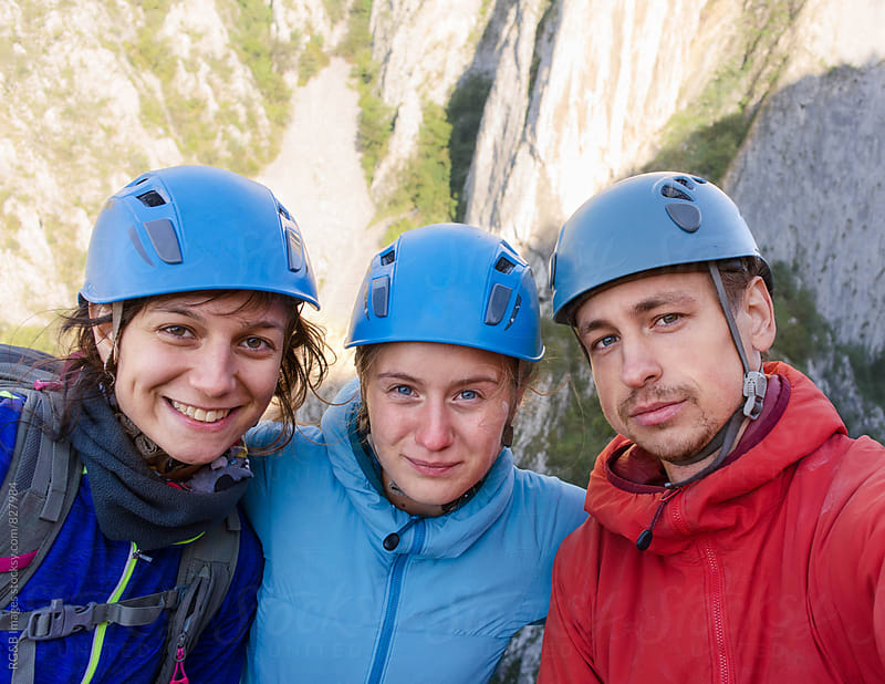 Friends rock climbing outdoor by RG&B Images for Stocksy United