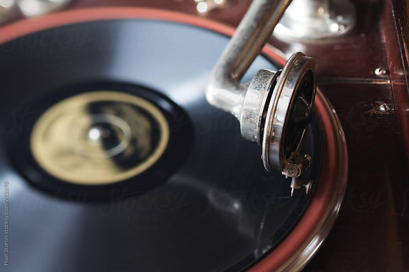 Old gramophone playing record by Pixel Stories for Stocksy United
