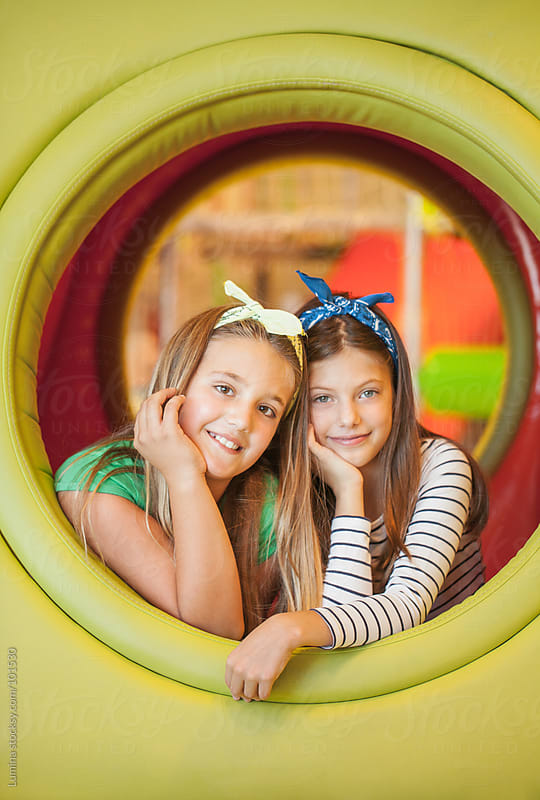 Girls in the Playroom Tunnel by Lumina for Stocksy United