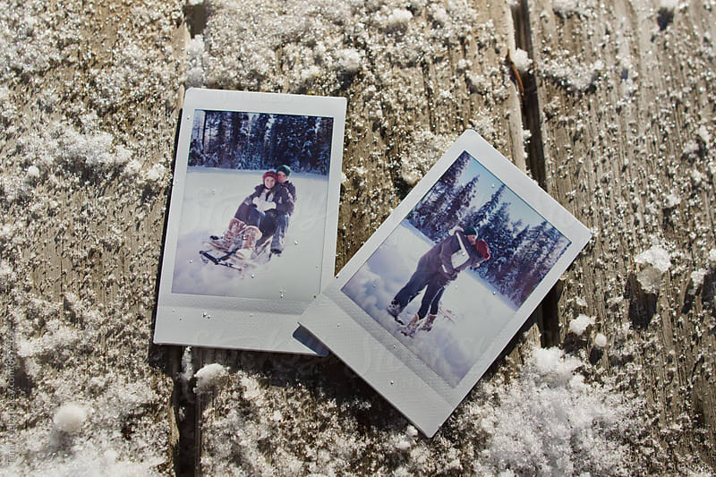 polaroid images of young couple playing in snow by Tana Teel for Stocksy United
