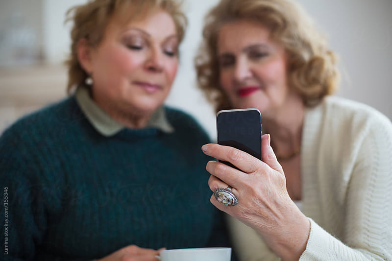 Senior Women With a Mobile Phone by Lumina for Stocksy United