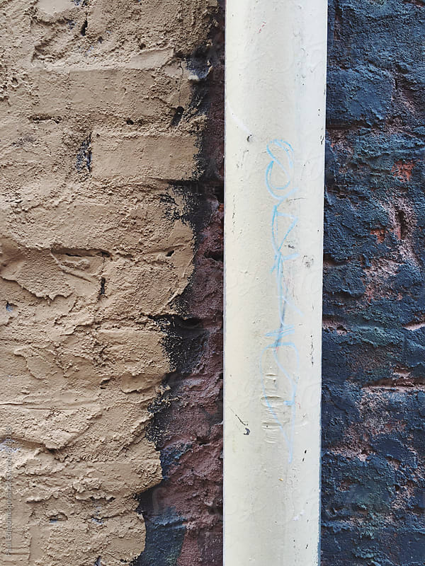 Close up of gutter pipe and brick wall by Paul Edmondson for Stocksy United