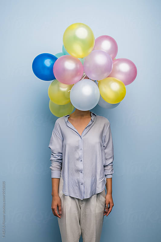 Unrecognizable girl with balloons over head by Danil Nevsky for Stocksy United