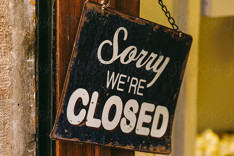 Sorry We are Closed Sign on a Shop Entrance by VICTOR TORRES for Stocksy United