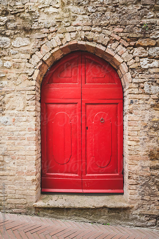 Closed Red Door in Tuscan Alley by Giorgio Magini for Stocksy United