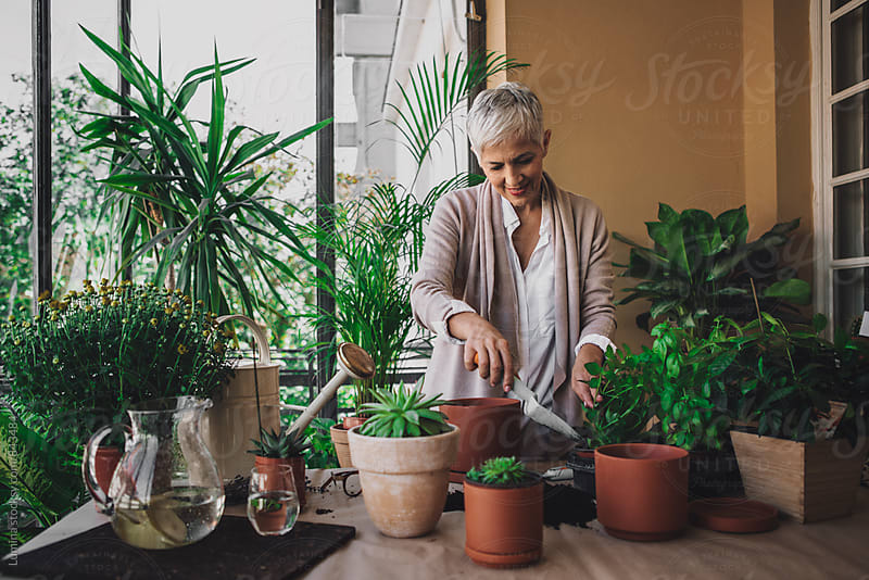 Woman Gardening at Home by Lumina for Stocksy United