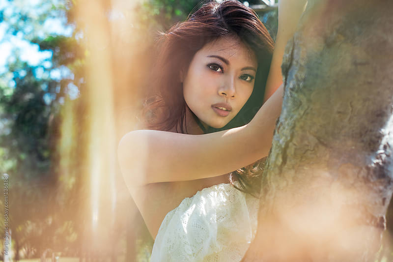 Portrait of beautiful Asian woman in the woods. by Marija Savic for Stocksy United