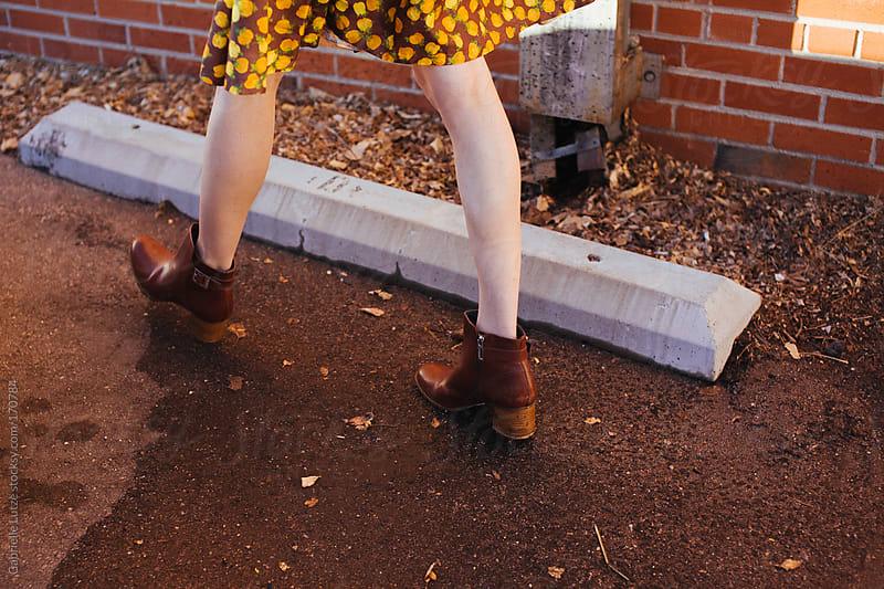Girl in Vintage Dress Walking in Parking Lot - Legs by Gabrielle Lutze for Stocksy United