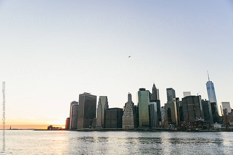 View of Manhattan island in New York city at sunset by Alejandro Moreno de Carlos for Stocksy United