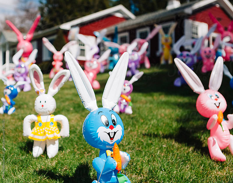 Blow Up Easter Bunnies on Lawn by Raymond Forbes LLC for Stocksy United