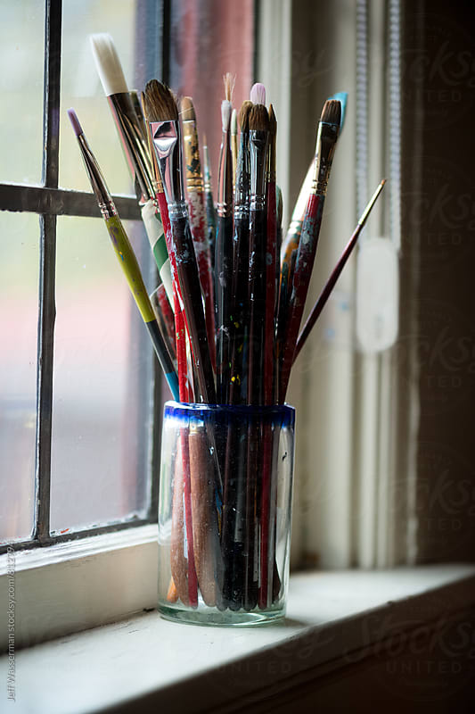 Artist's Paintbrushes on Window Sill by Jeff Wasserman for Stocksy United