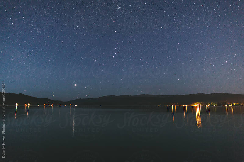 Stars over a mountain lake at night by Dylan M Howell Photography for Stocksy United