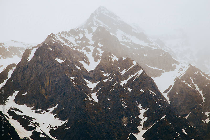 Snow mountains by Artem Zhushman for Stocksy United