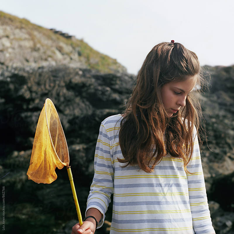 Young woman holding  fishing net by Léa Jones for Stocksy United