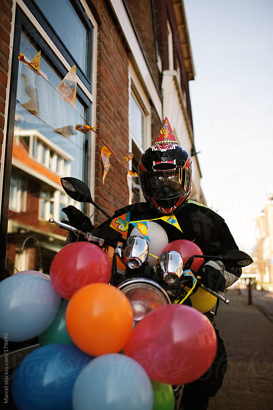 Motorcyclist dummy celebrating a birthday by Marcel for Stocksy United