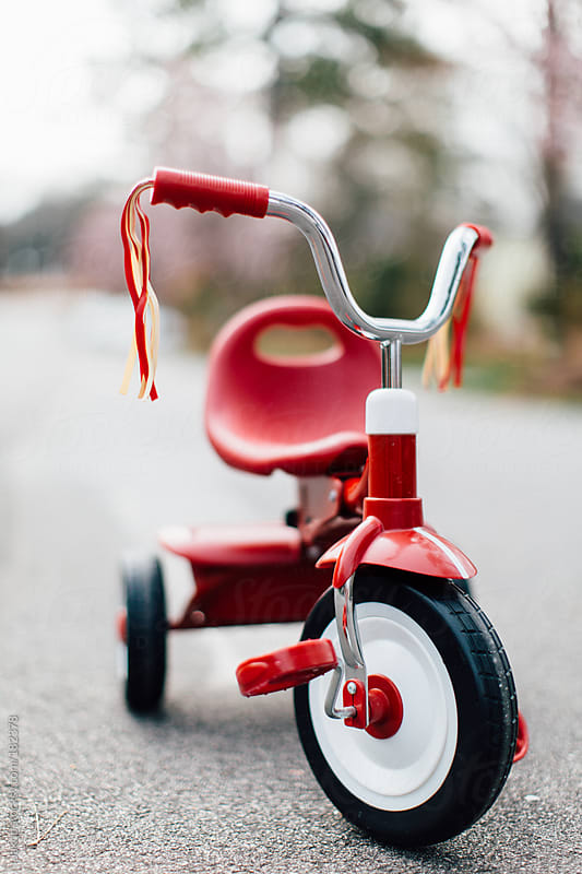 A tricycle parked in the middle of a street by Jakob for Stocksy United