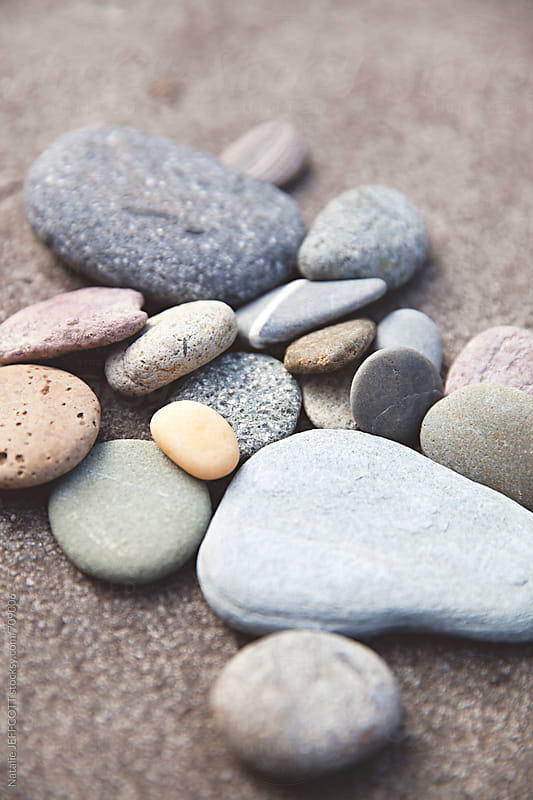 a collection of beautiful weathered stones found on a beach by Natalie JEFFCOTT for Stocksy United