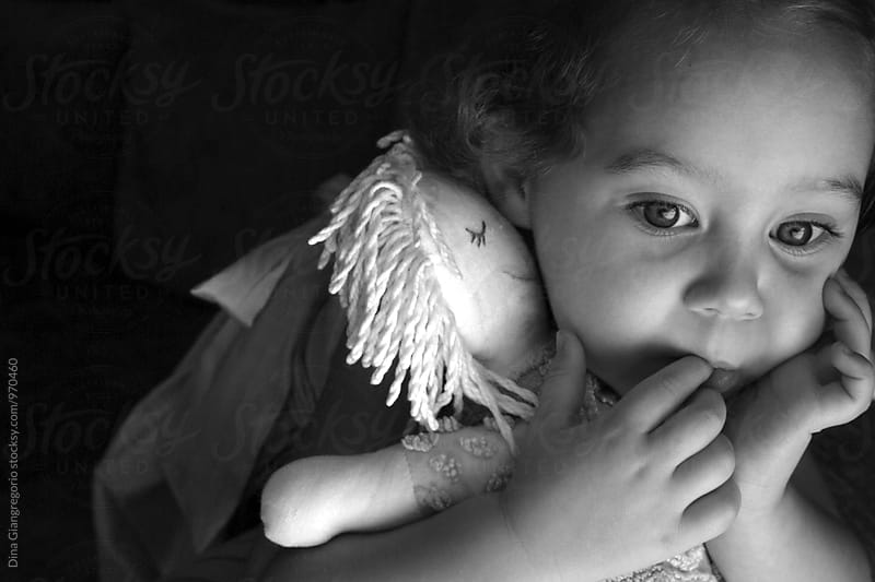 Little Girl In Natural Light Holding Rag Doll by Dina Giangregorio for Stocksy United